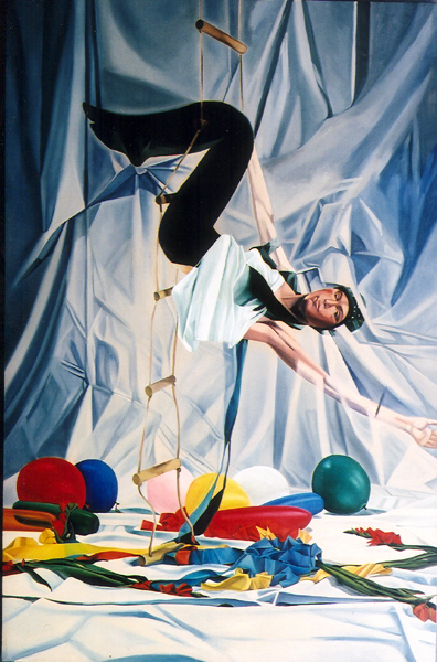 A woman hangs from a rope ladder suspended from ceiling. Balloons, streamers and flowers lay on the ground beneath her.