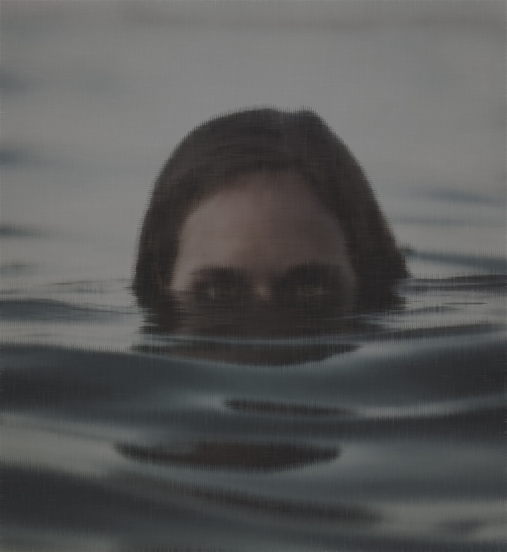 A head of a man or woman half-submerged in water.