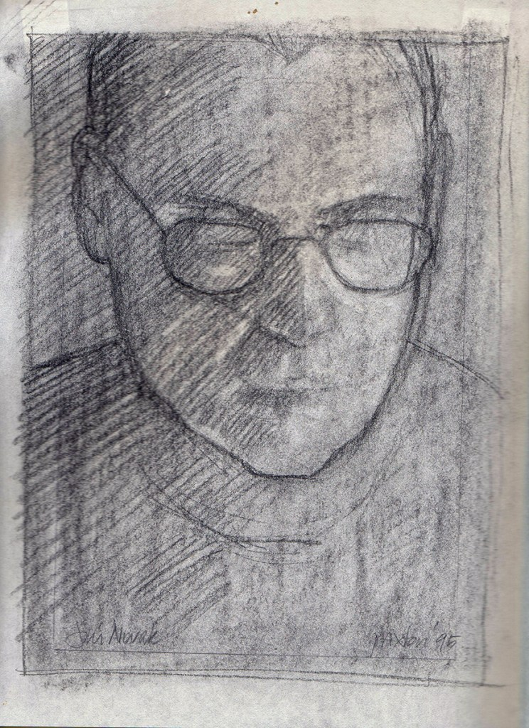 Artwork by Maureen Paxton. A small study, a charcoal drawing of a man wearing glasses and looking downwards.