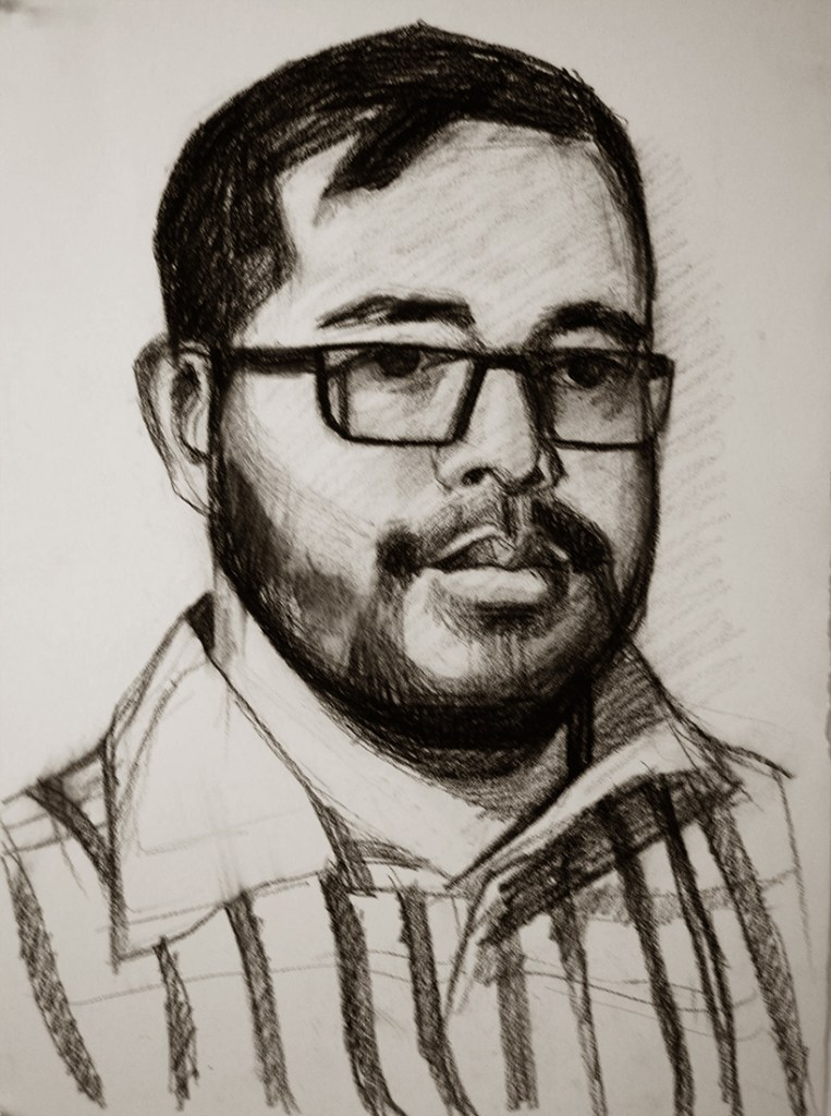 Artwork by Maureen Paxton. A small study, a charcoal drawing of a young bearded man with striped shirt and glasses.