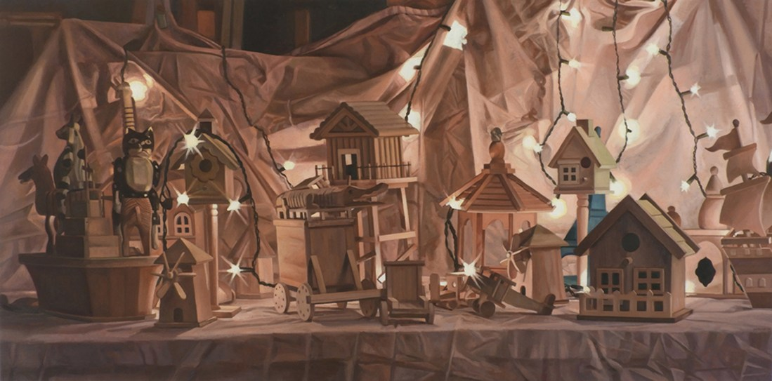 Artwork by Maureen Paxton. A still-life composed of various wooden birdhouses, plus two Indonesian sitting puppets